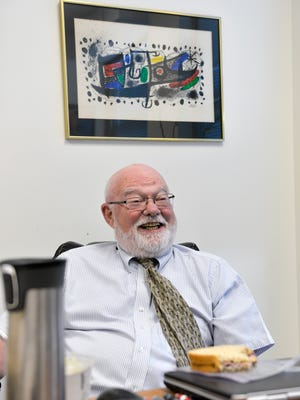 Stearns County Public Defender Denis Hynes smiles as he talks over a brown bag lunch in his office Tuesday, July 26, in downtown St. Cloud. Hynes turns 75 next year and is still going strong.