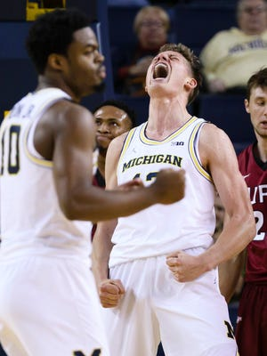 Nov 13, 2016; Ann Arbor, MI, USA; Michigan Wolverines forward Moritz Wagner reacts after a basket in the second half against the IUPUI Jaguars at Crisler Center.