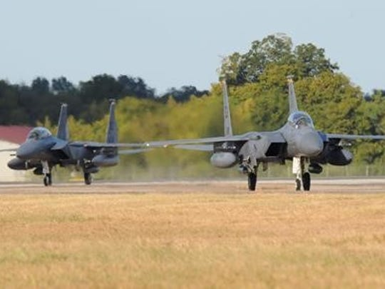 Two F-15 Strike Eagles from Seymour Johnson Air Force Base, N.C., taxi down the runway at Barksdale Air Force Base, La., Oct. 4, 2016. Hundreds of Airmen and a large contingent of aircraft including F-15 Strike Eagles, F-16 Fighting Falcons, C-17 Globemaster IIIs and KC-135 Stratotankers began arriving here today from Shaw Air Force Base, S.C., Charleston Air Force Base, S.C., and Seymour Johnson, to avoid potential damage from high winds associated with Hurricane Matthew along the East Coast.
