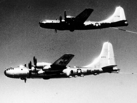 """An airplane refuels the """"Lucky Lady II"""" during the"""