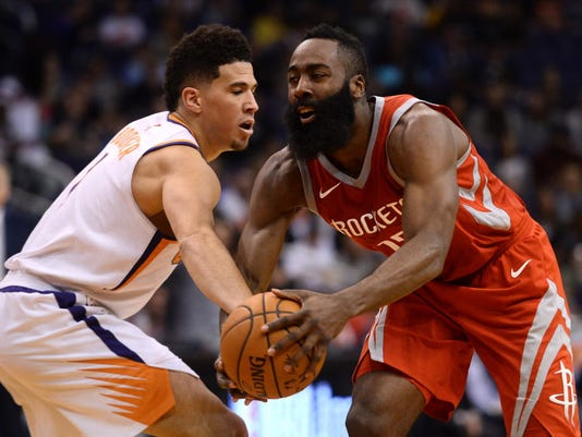 7d51f583deca USP NBA  HOUSTON ROCKETS AT PHOENIX SUNS S BKN PHX HOU USA AZ. James Harden  drives against Phoenix Suns guard Devin Booker during the second half at  Talking ...