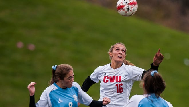 CVU #16 Natalie Durieux gets to the header over South Burlington #8 Madison Druzba during their semi final girl's soccer semifinal in Hinesburg on Wednesday, Nov. 1, 2017. CVU pulled off the win in sudden-death overtime, 1-0.