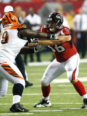 Peter Konz of the Atlanta Falcons battles against a Cincinnati Bengal on Aug. 16, 2012. The former Neenah High School star's career with the Atlanta Falcons ended after three years Tuesday.