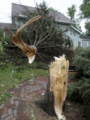 An August 2013 storm damaged vehicles and homes and