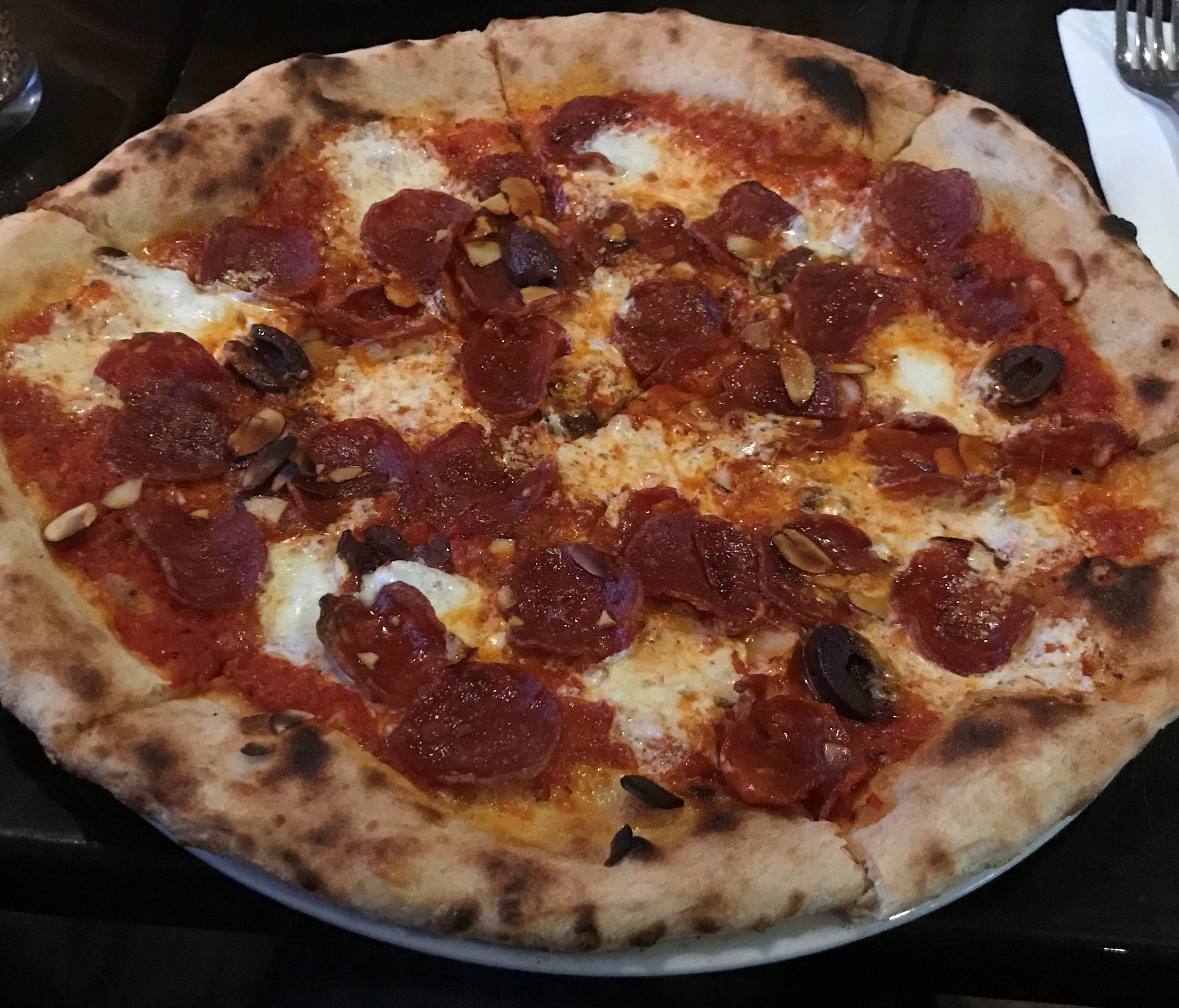 The signature pizza is the Spain, with fresh mozzarella, chorizo sausage, Spanish almonds, olives and a mild harissa pepper sauce.