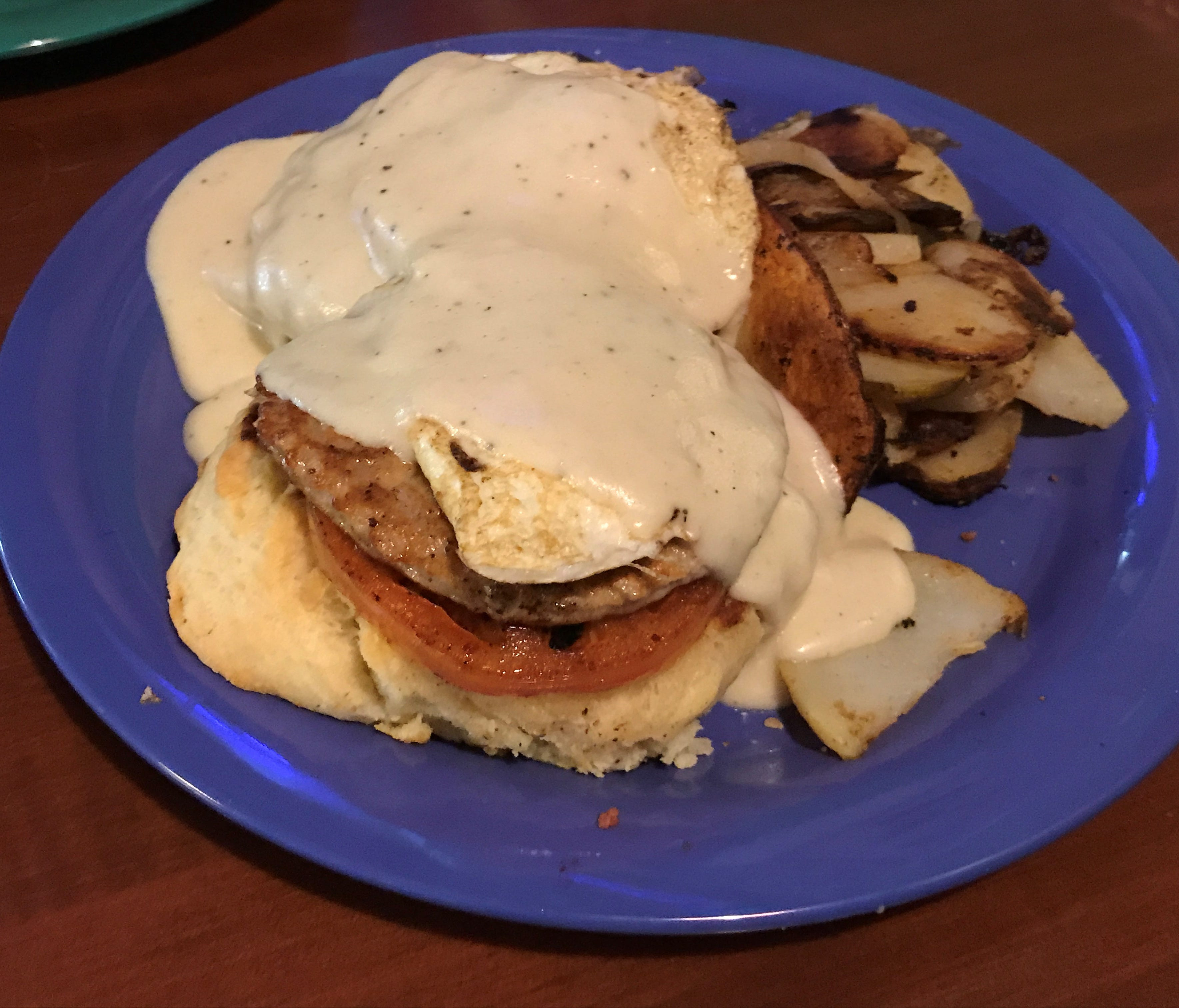 One unique take on a breakfast sandwich starts with a very good biscuit, adds a patty of house-made sausage, grilled tomato, an over easy egg and standout country-style gravy, plus a choice of a side, such as hash browns.