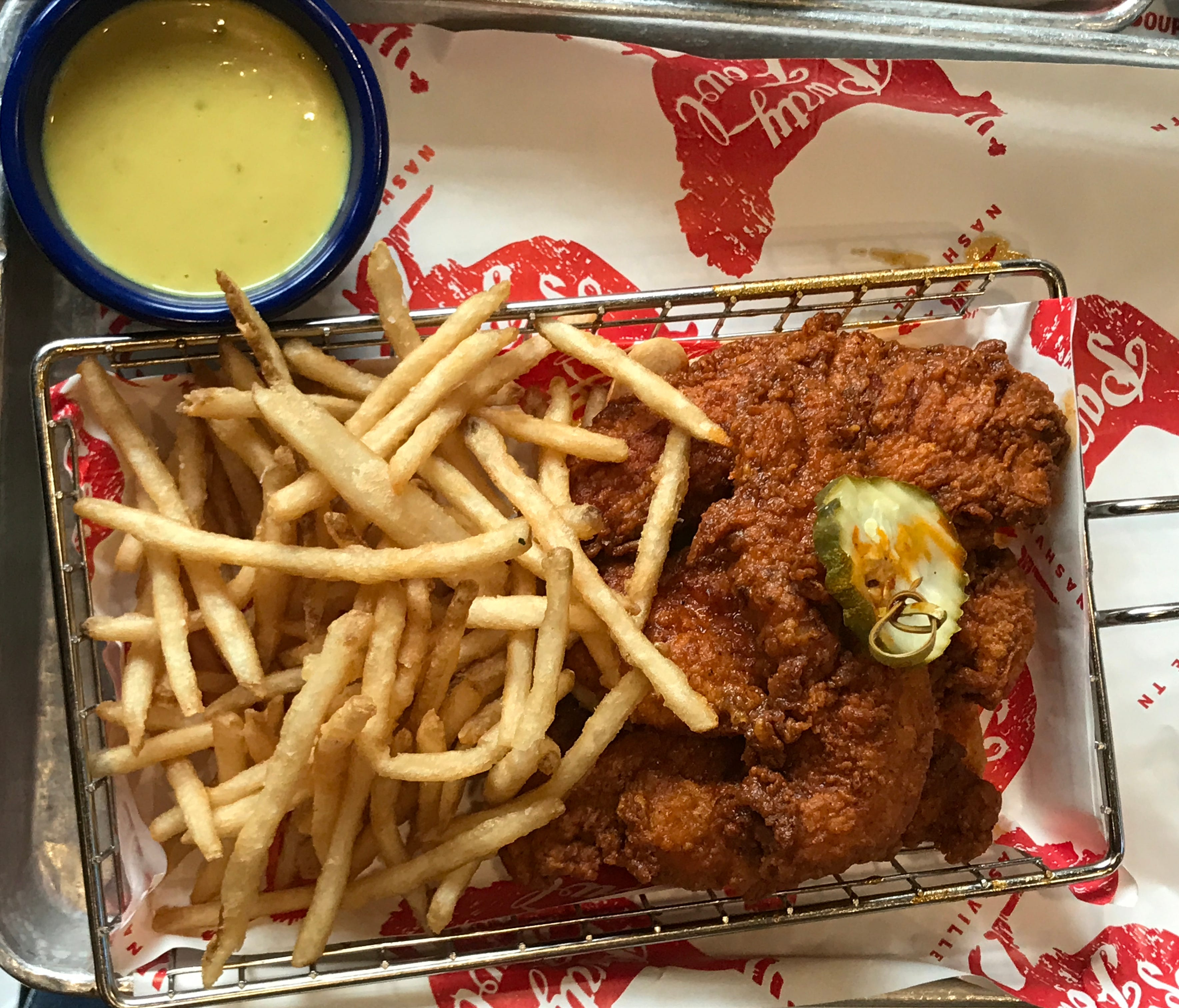 Yet another way to try a variation on classic Nashville Hot Chicken is in the form of tenders with mustard dipping sauce.