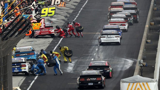 Cars pit during the NASCAR Cup Series Big Machine Hand Sanitizer 400 Powered by Big Machine Records at Indianapolis Motor Speedway on July 5 in Indianapolis.