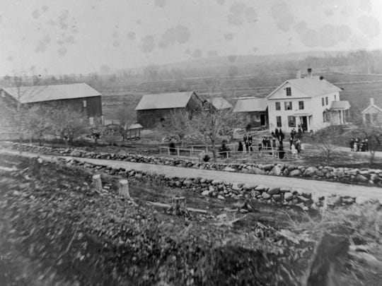 Luther Witt farm west of Plymouth, section 21, with its stone fence lining the road with the freshly deforested farm field. This area is today on Western Avenue, east of Woodlawn Cemetery.
