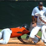 Opelousas Catholic first baseman fields the pick-off attempt during the Vikings' 3-2 playoff win.