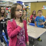 Kimm Anderson, kanderson@stcloudtimes.com Lily Jonak, center, and the other students in Erin Tronbak's kindergarten class say the Pledge of Allegiance on Friday, at Pleasantview Elementary School in Sauk Rapids. Lily Jonak, center, and the other students in Erin Tronbak's kindergarten class say the Pledge of Allegiance Friday, Dec. 11 at Pleasantview Elementary School in Sauk Rapids.