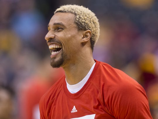 Indiana Pacers guard George Hill (3) enjoys a laugh during pre-game warmups of an NBA basketball game, Tuesday, Jan. 26, 2016, at Bankers Life Fieldhouse in Indianapolis.