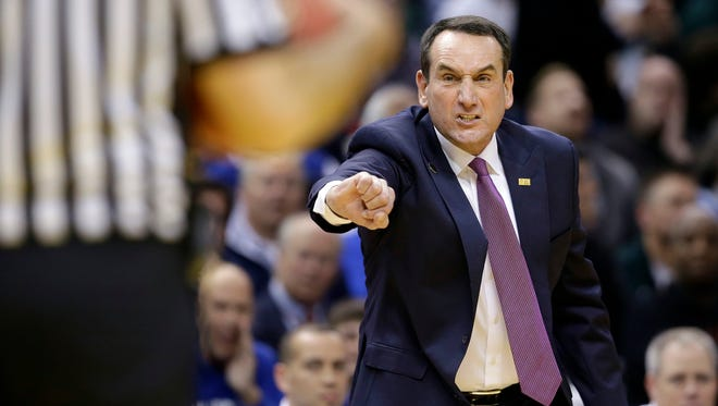 Duke basketball coach Mike Krzyzewski argues a call against the Michigan State on Nov. 18, 2014, in Indianapolis.