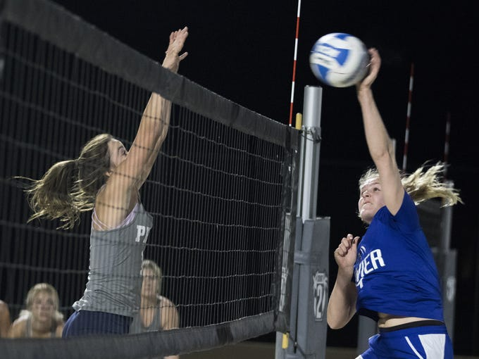 Xavier's Shannon Shields(right) powers one past Perry's
