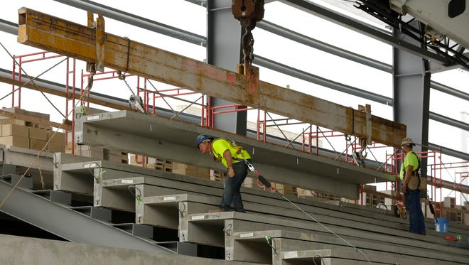 Construction crews from Bayland Buildings were setting the bleacher area and Pahlow Masonry continues to work on the masonry work at the Oshkosh Arena Friday, August 18, 2017.  The Oshkosh Arena is expected to be completed by November of 2017 and it will be the home of the Milwaukee Bucks G-League team the Wisconsin Herd.Joe Sienkiewicz / USA TODAY NETWORK-Wisconsin