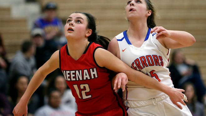 Megan Lee of Neenah and Sydney Gehl of Appleton West position for a rebound in an FVA game Tuesday, February 6, 2018, at Appleton West High School in Appleton, Wis.Ron Page/USA TODAY Network-Wisconsin