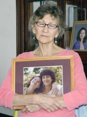 Mary Craver Rose clutches a photograph of her daughter, Annette Vail, who disappeared in 1984 and is presumed dead. Annette's husband, Felix Vail, is the last known person to see her alive. He goes on trial Aug. 8, 2016, and Rose is expected to testify about her daughter's disappearance.