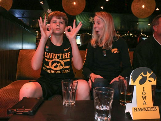 Mitch Houge, 14, of Slater cheers alongside his mom,