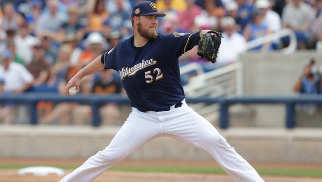 Brewers starting pitcher Jimmy Nelson works in the first inning against the Giants at Maryvale Baseball Park on Wednesday.