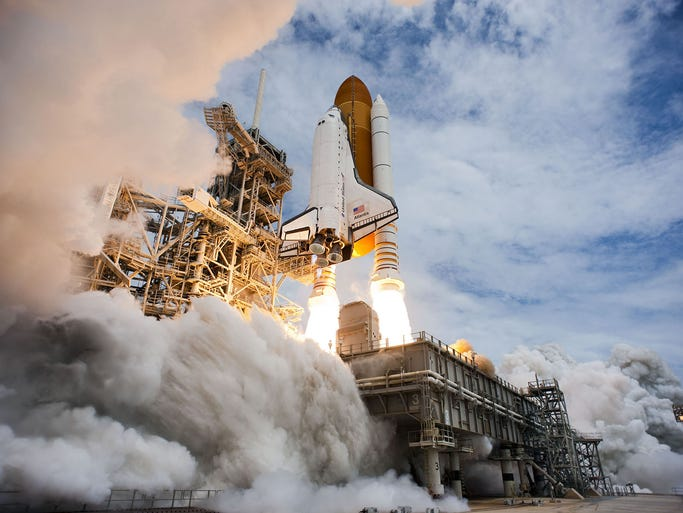 The space shuttle Atlantis lifts off from Launch Pad 39A on a mission to the International Space Station on July 13, 2011, at the Kennedy Space Center in Cape Canaveral, Fla.
