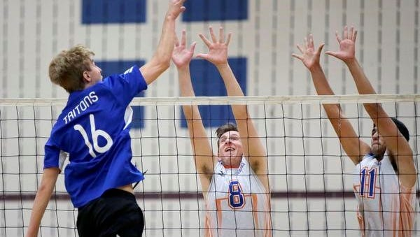 Zach Sengstock of Notre Dame Academy tries to get the ball over Alex Kiley, left, and Pinder Singh of Appleton West during the Fox Valley Association boys volleyball tournament Saturday at Appleton North High School.