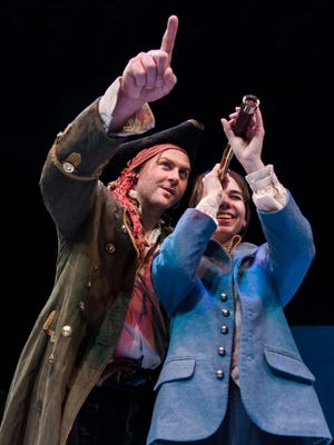 "Eric D Pasto-Crosby, left, as Long John Silver and Kristin McCalley as Jim Hawkins in ""Treasure Island."""