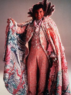 This 1987 file photo shows Liberace wearing his shiny rings and dress.