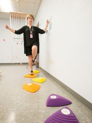 Occupational therapist Loretta Cichon Meach demonstrates the stepping stones used in the new Sensory-Motor Classroom utilized by the ESE (Exceptional Student Education) program at Booker T. Washington High School in Pensacola.  May 26, 2017.