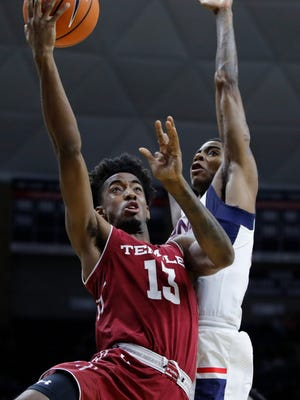 Temple Owls guard Quinton Rose (13) moves to the basket against Connecticut Huskies guard Terry Larrier (22) in the second half at Gampel Pavilion. UConn defeated Temple 72-66. Mandatory Credit: David Butler II-USA TODAY Sports