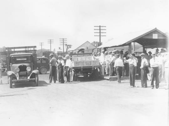 A strawberry auction in Bridgeville from 1935.