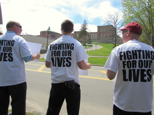 With the Elmira Correctional Facility looming in the background, correction officers picket Monday to draw public attention to what they call unsafe working conditions.