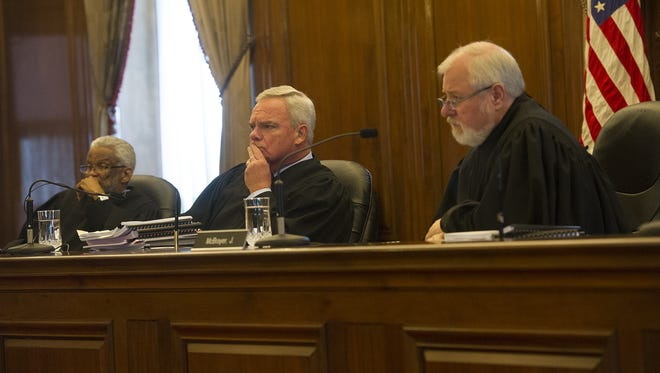 The Tennessee Court of Appeals hears arguments for and against the release of records in the investigation of a high profile rape case at Vanderbilt University at the Tennessee Supreme Court Building Monday, June 9, 2014 in Nashville, Tenn. From left,  Judge Richard H. Dinkins, Presiding Judge Frank G. Clement, Jr., and Judge W. Neal McBrayer.