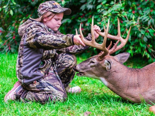 Maddie Marsh with a big buck she killed in Indiana