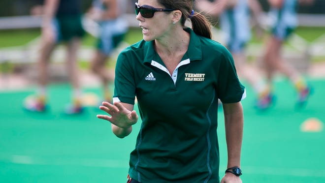 Kate Pfeifer, coach of the University of Vermont's field hockey team, explains a drill during practice in Burlington on Monday, August 18, 2014.