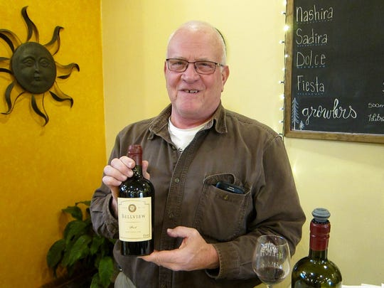 Bellview's Jim Quarella with bottle No. 1 of his winery's current Port. The winery hosts Vinyasa & Vino on Sunday.
