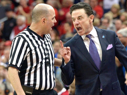 FILE - In this Feb. 20, 2016, file photo, Louisville head coach Rick Pitino, right, argues with referee Brian Dorsey during the second half of an NCAA college basketball game against Duke, in Louisville Ky. Louisville's Athletic Association has officially fired coach Rick Pitino, Monday, Oct. 16, 2017, nearly three weeks after the school acknowledged that its men's basketball program is being investigated as part of a federal corruption probe. (AP Photo/Timothy D. Easley, File)