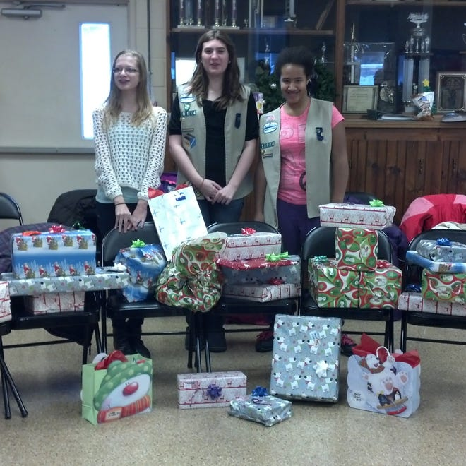 From left, Taylor Triola, Kira Brainard and Angelina Volino display the gifts and items collected for Grace Smith House.