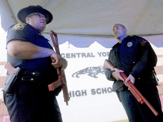 Officers hold mock guns outside Central York High School