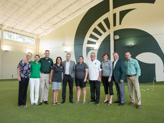 A number of MSU coaches pose with Mark Hollis and golf coaches Stacy Slobodnik-Stoll and Casey Lubahn at the dedication of the Lasch Family Golf Center on Wednesday in East Lansing.
