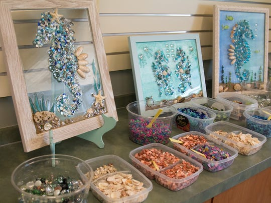 The first enrichment program offered by the Arts in Medicine program at the Robert and Carol Weissman Center allowed participants to use seashells, stones and other decorations to create a seahorse design on a pane of glass.