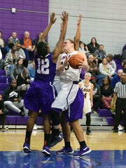 LSUA's Taylor Holzmeier (15, right) looks to score over Wiley College's Anika Nottingham (12, left) Saturday.-Melinda Martinez/The Town Talk