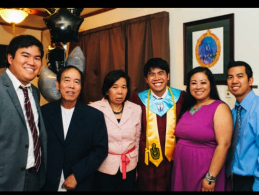 Paul Kieu and his family at his brother's high school graduation from Vermilion Catholic in May 2013.