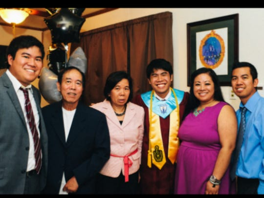 Paul Kieu and his family at his brother's high school
