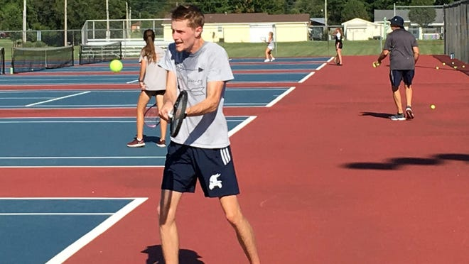 New Seaman girls tennis coach Andrew Gill practices with his team in the preseason.
