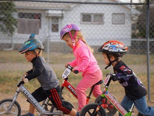 2 Kids Riding