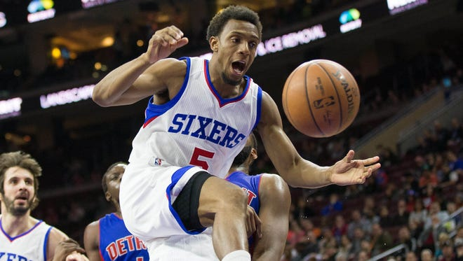 Philadelphia 76ers guard Ish Smith loses control of the ball as he goes for a shot against the Detroit Pistons.