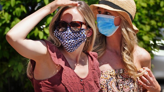 City residents and visitors wear face masks into businesses, and outdoors when social distancing is difficult.