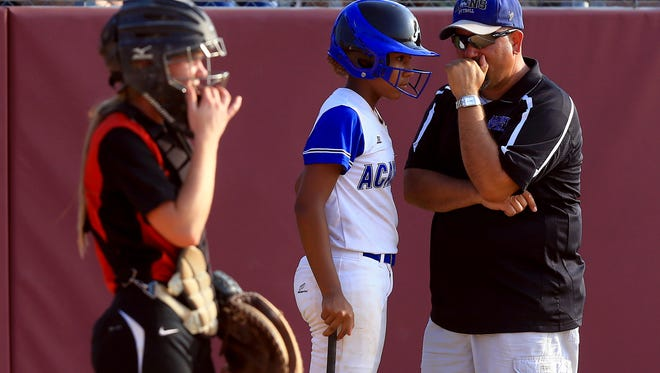 Santa Gertrudis Academy's head coach Thomas De Los Santos talks to Breana Carr during the Region IV-3A softball final on Friday, May 26, 2017, at Tuloso-Midway High School in Corpus Christi.