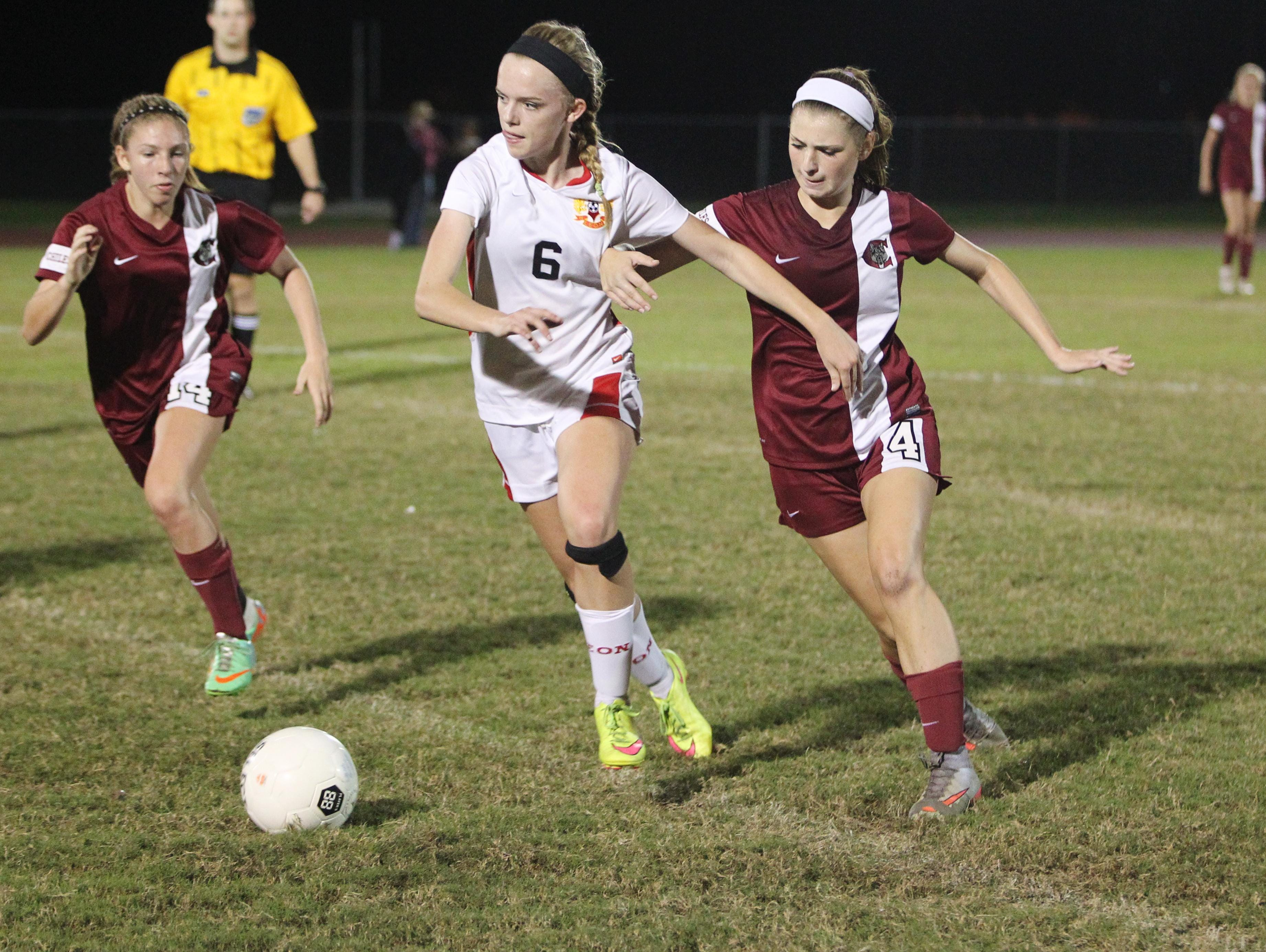 Leon sophomore Maddie Powell eyes a pass during a game against Chiles on Tuesday night. Powell has switched to the midfield after scoring over 20 goals as a forward last year. The Lions won 3-0 last night and Powell had a goal on a header.