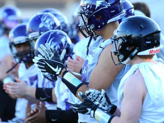 ACU players line up to run sprints during the first day of spring practice Thursday, March 1, 2018 at Wildcat Stadium.